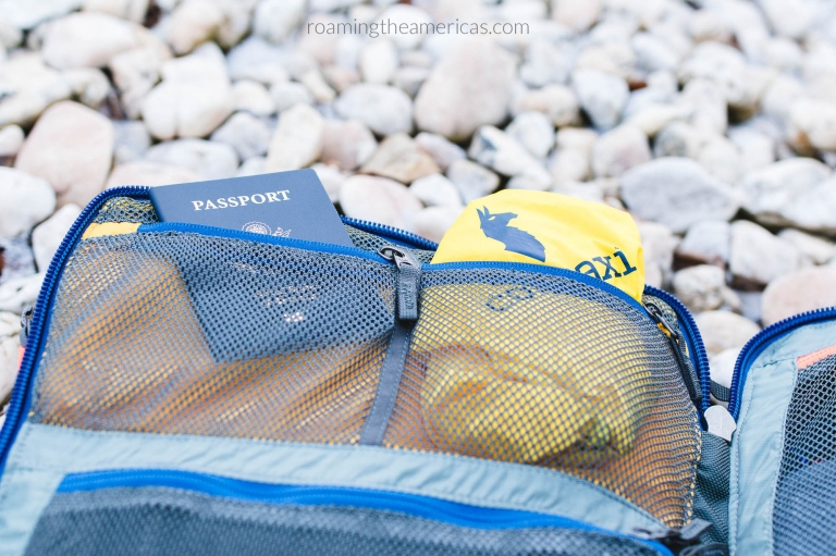 Passport and rain cover inside zippered mesh compartments of the Allpa 35L backpack