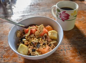 Tropical fruit with granola and coffee on a table at a Spanish school in Nicaragua