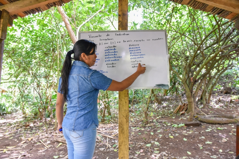 Learning Spanish outside in Nicaragua - teacher writing conjugations on a whiteboard