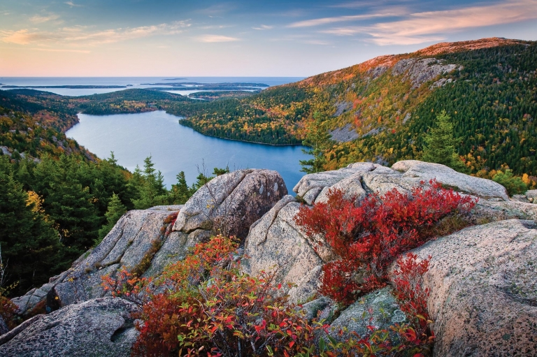 View of fall foliage from a mountain in Acadia National Park in Maine
