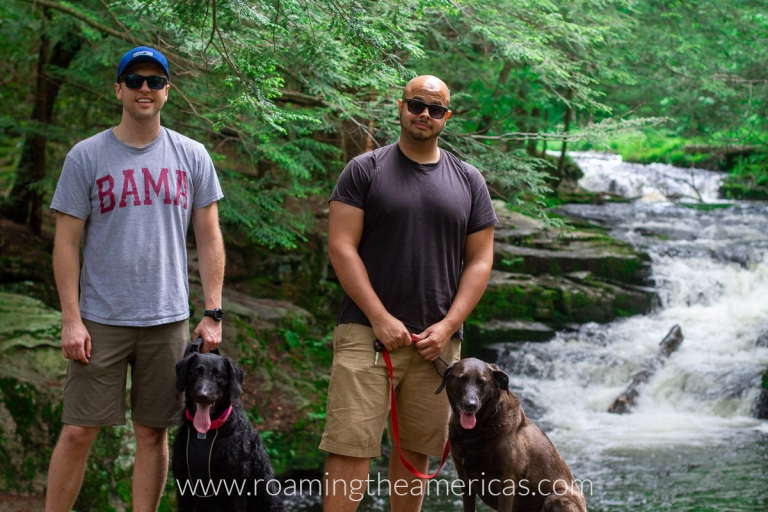 Hiking with friends and our dogs near a waterfall