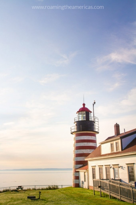 View of the candy-striped West Quoddy Head Lighthouse at the easternmost point in the United States on the Maine coast | Escape the Crowds in Acadia National Park — 12 Under-the-Radar Things to Do Nearby