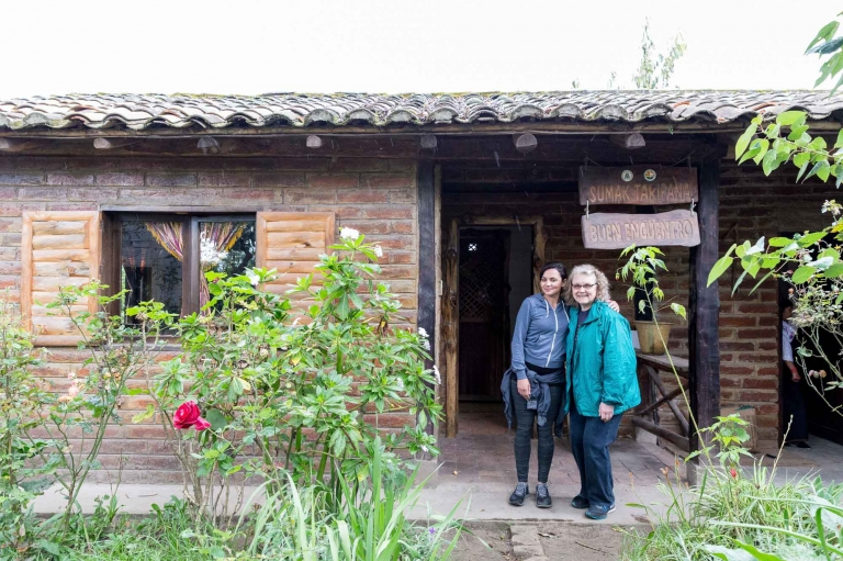 Two women outside of a home near Cotocachi, Ecuador