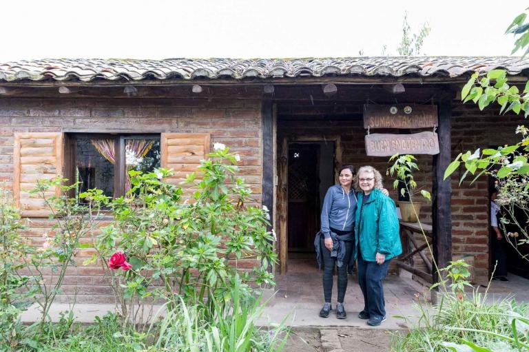 Two women outside of a home near Cotocachi, Ecuador