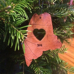 Maine-shaped Christmas tree ornament with a heart in the middle