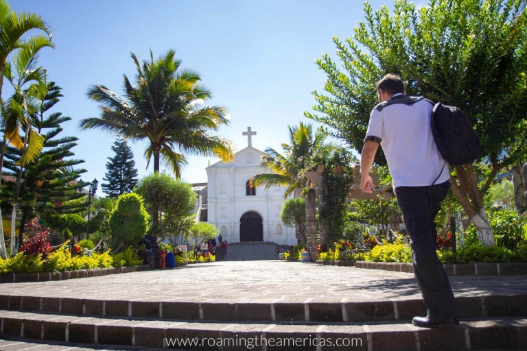 Church surrounded by palm trees in a plaza in San Pedro La Laguna, Guatemala near Lake Atitlan
