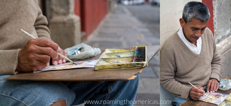 Man painting scenes of Guatemala on a street in Antigua