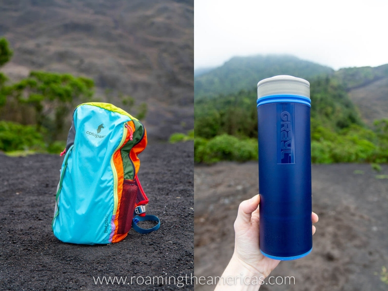 Cotopaxi Batac 16L backpack and blue Grayl water purifier on top of a volcano in Guatemala