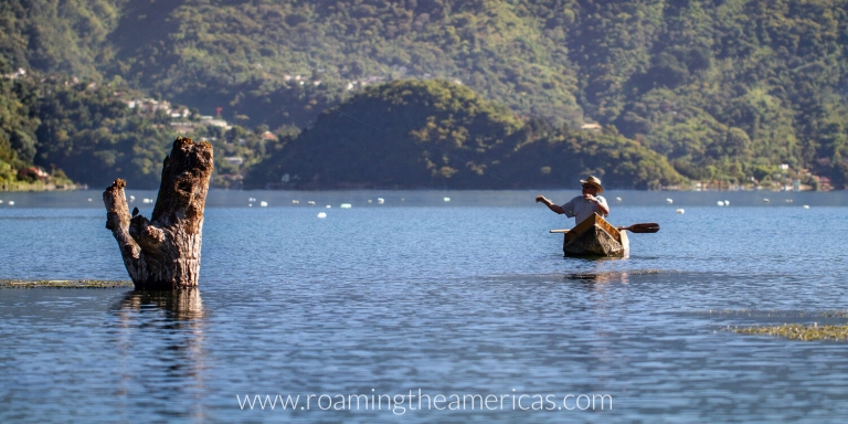 A man fishing in a boat on Lake Atitlan, Guatemala near San Juan La Laguna