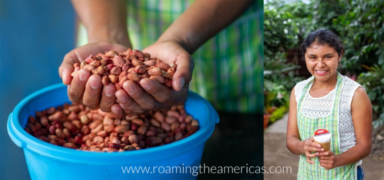 Young woman with a handful of peanuts in her backyard in Guatemala
