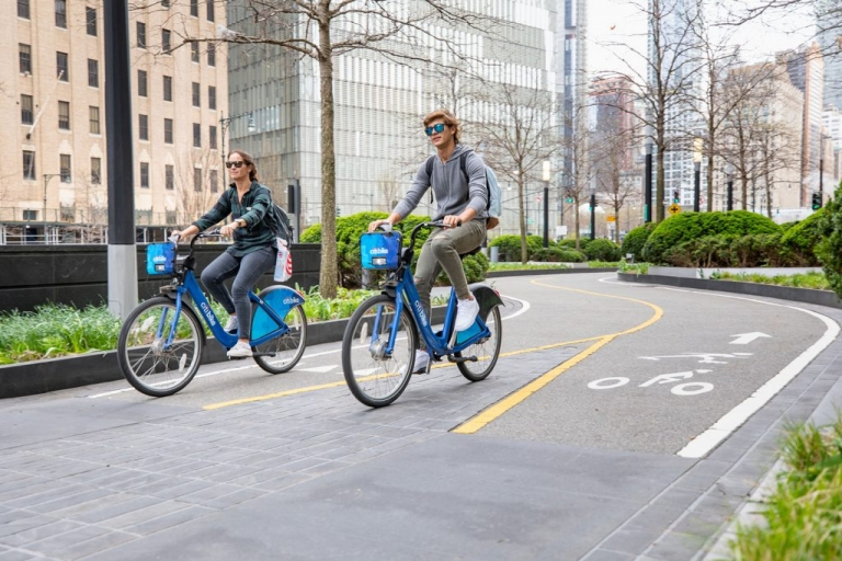 Man and woman biking on a bike path in New York City