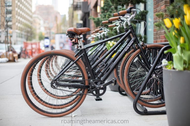 Brown and black bikes lined up on a bike rack at Arlo Soho Hotel in downtown Manhattan