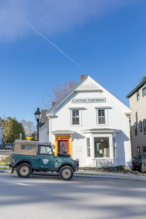Green jeep in front of Castine Emporium storefront