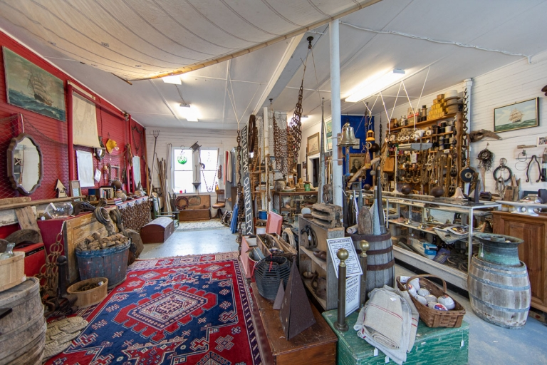Assorted maritime-inspired goods and antiques inside a shop in Stonington, Maine
