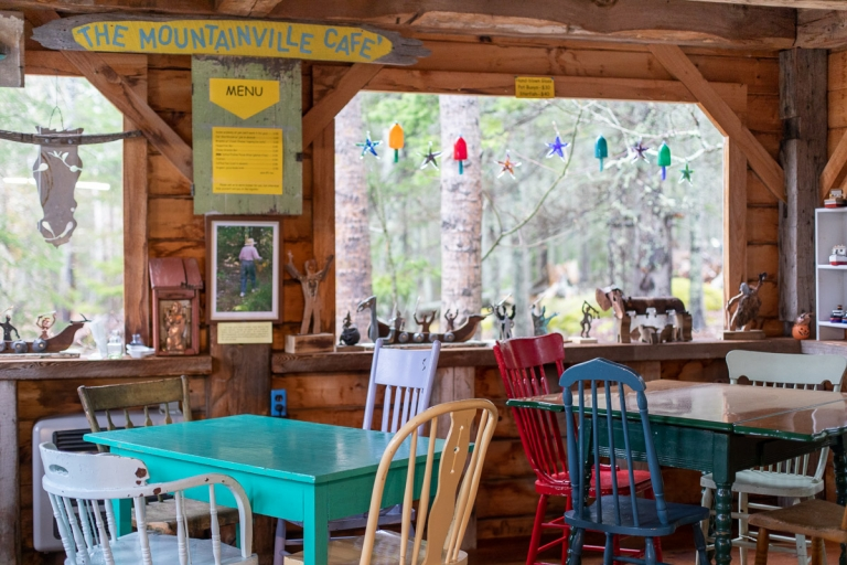 Colorful tables and chairs inside the Mountainville Cafe at Nervous Nellie's on Deer Isle