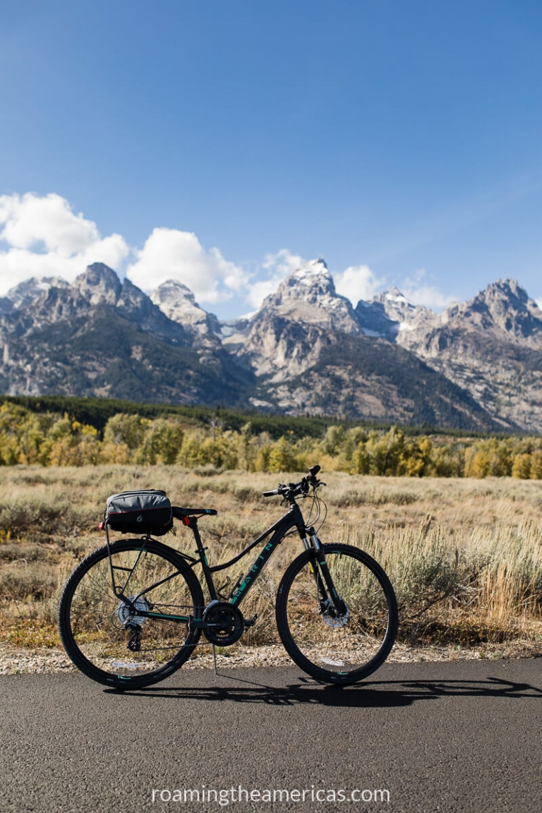 Bike on a paved pathway with Grand Teton Mountains in the background