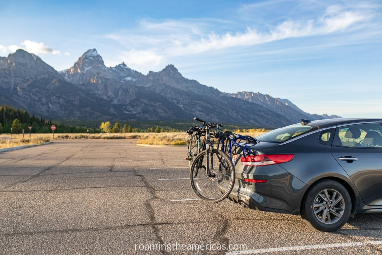Bikes on a car bike rack with the Teton Mountains in the background