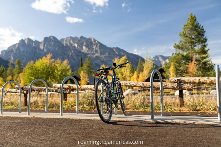 Bike in a bike rack with Grand Teton Mountains in the background